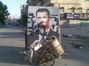 zniszczony.plakat.asad.syria